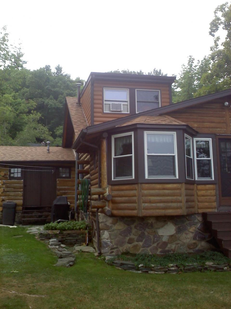 Timbermill siding on log cabin windows siding and for Windows for log cabins
