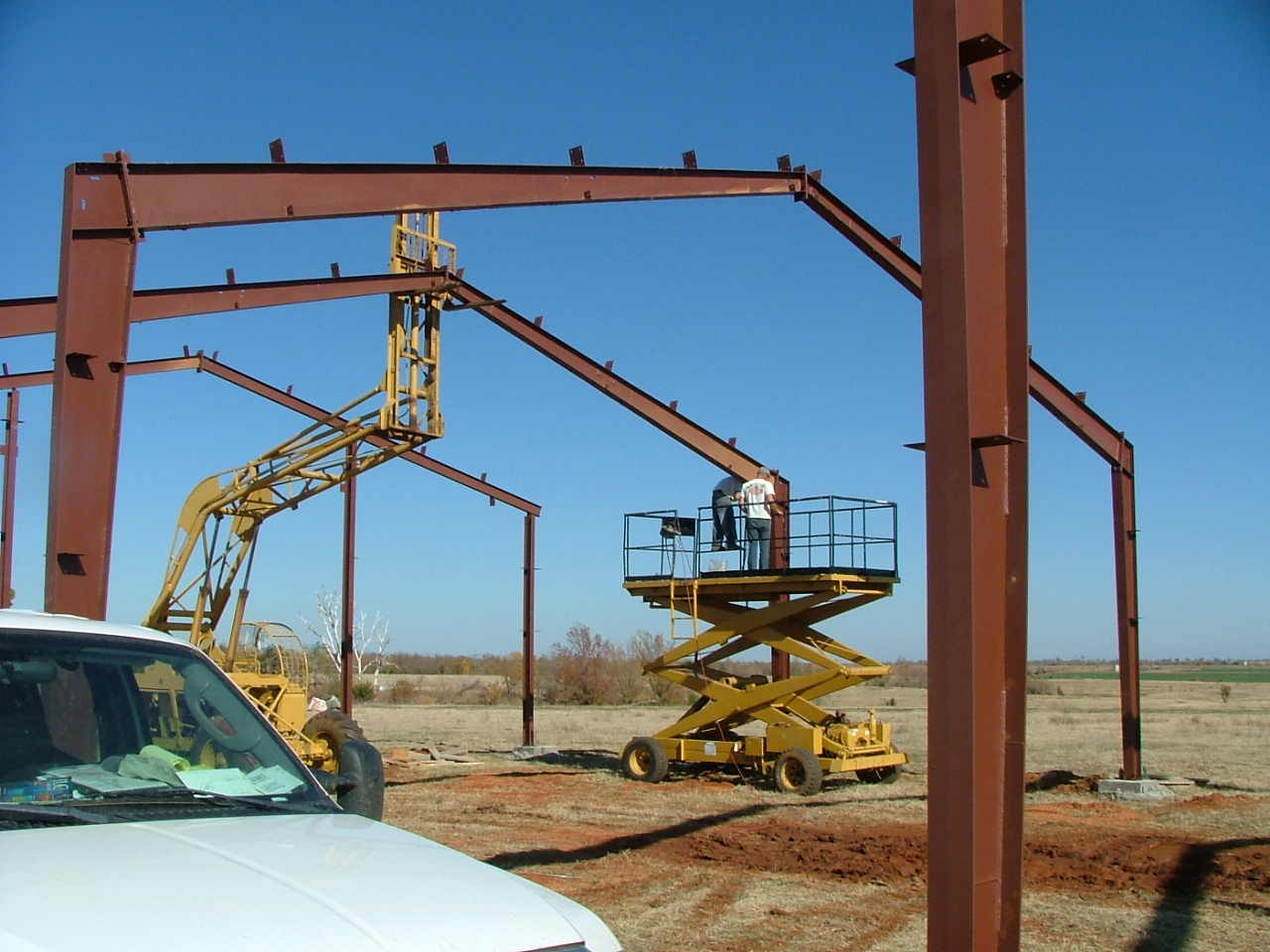 Clear span steel building start construction picture for Building a house on concrete piers