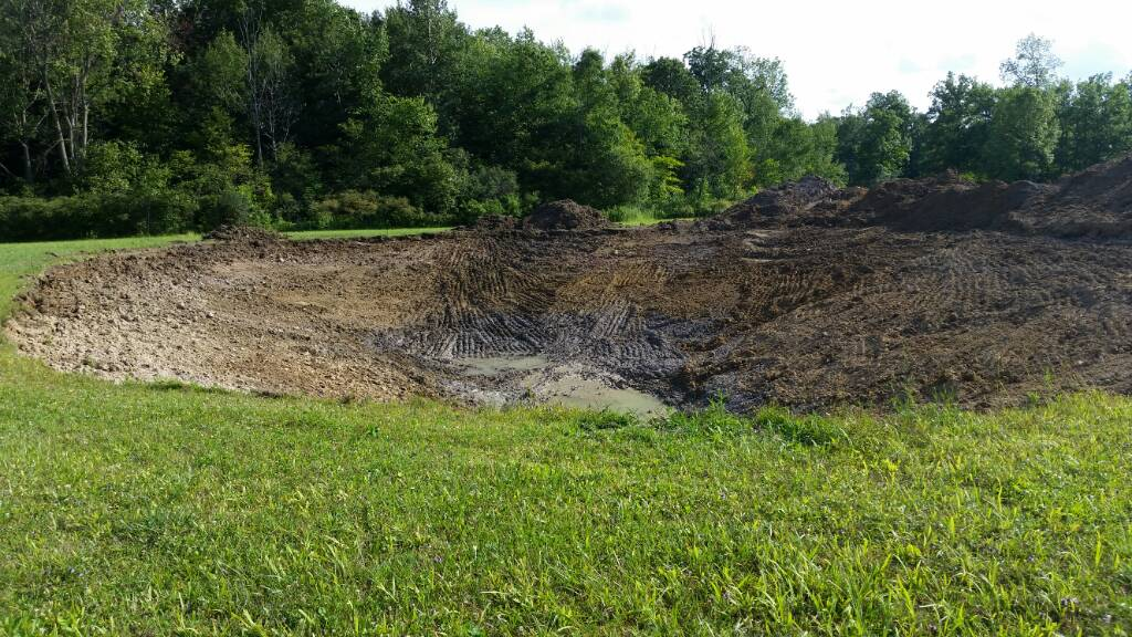 Geothermal and Pond dig-1437439259073.jpg