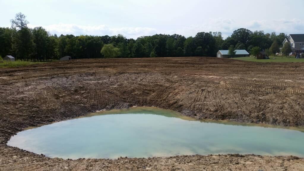 Geothermal and Pond dig-1440468940081.jpg
