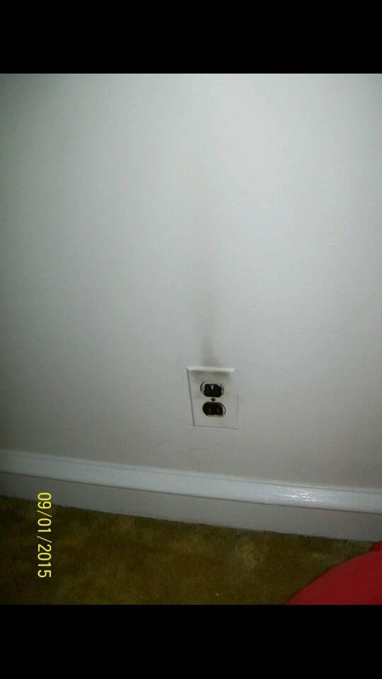 Black soot above receptacles-1441670180571.jpg