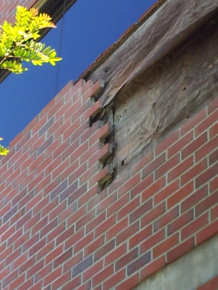 Veneer stone over top of acrylic stucco page 2 masonry for How to install stone veneer over stucco