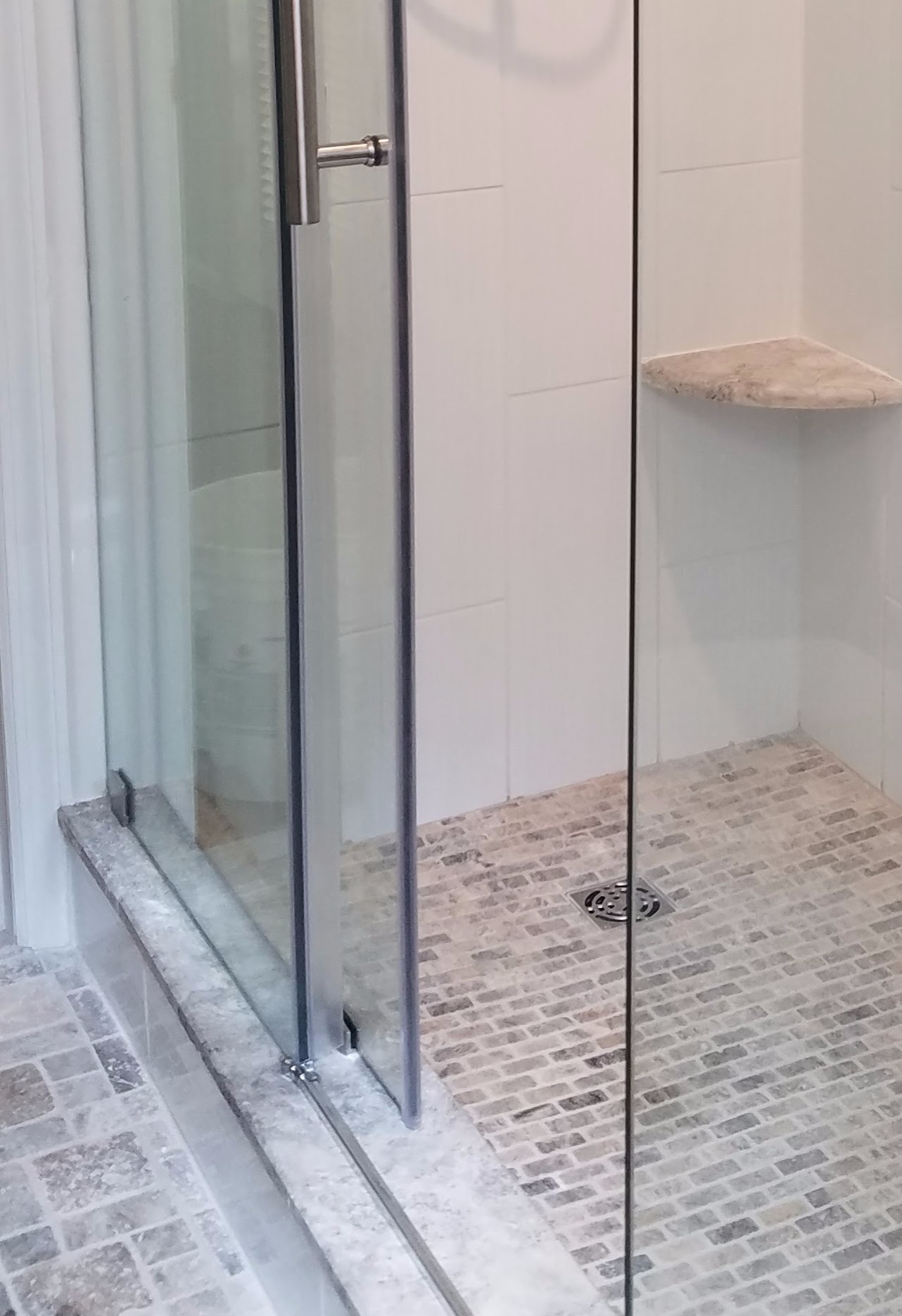 Water Running Under Glass Shower Door Kitchens Baths