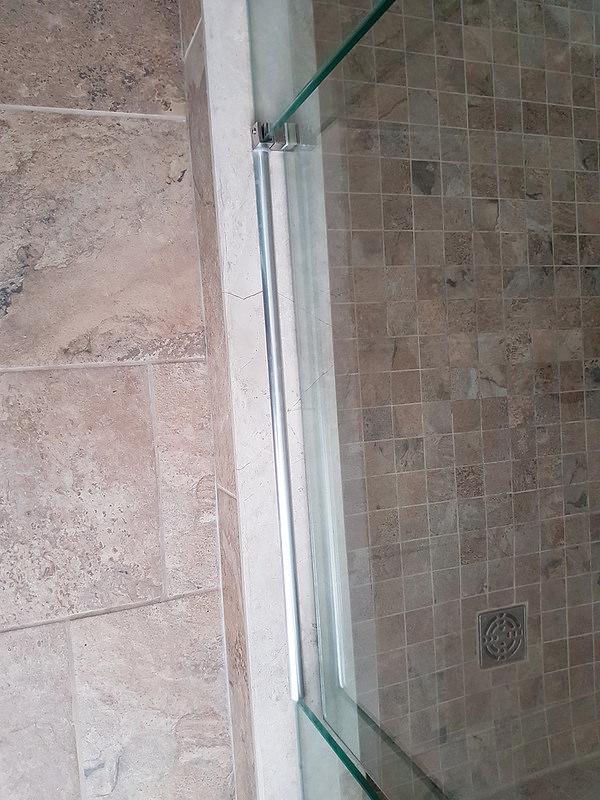 Water Running Under Glass Shower Door-30870992573_9d7d354a30_c.jpg