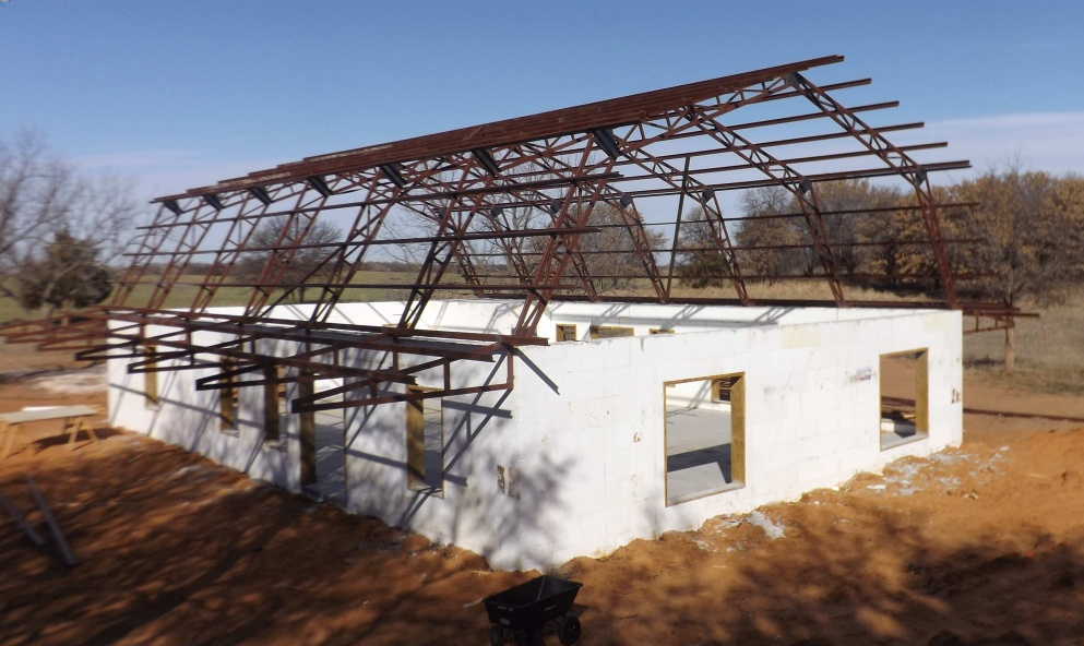Icf home steel roof system a different way to build for Icf house
