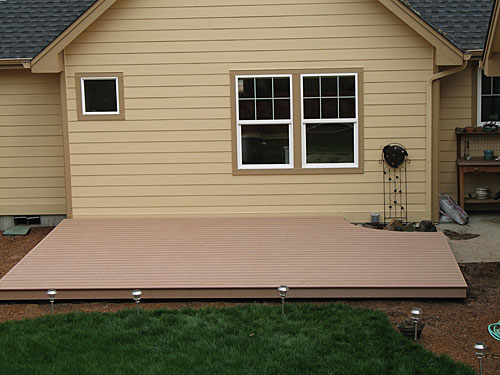 how to build a ground level deck on uneven ground