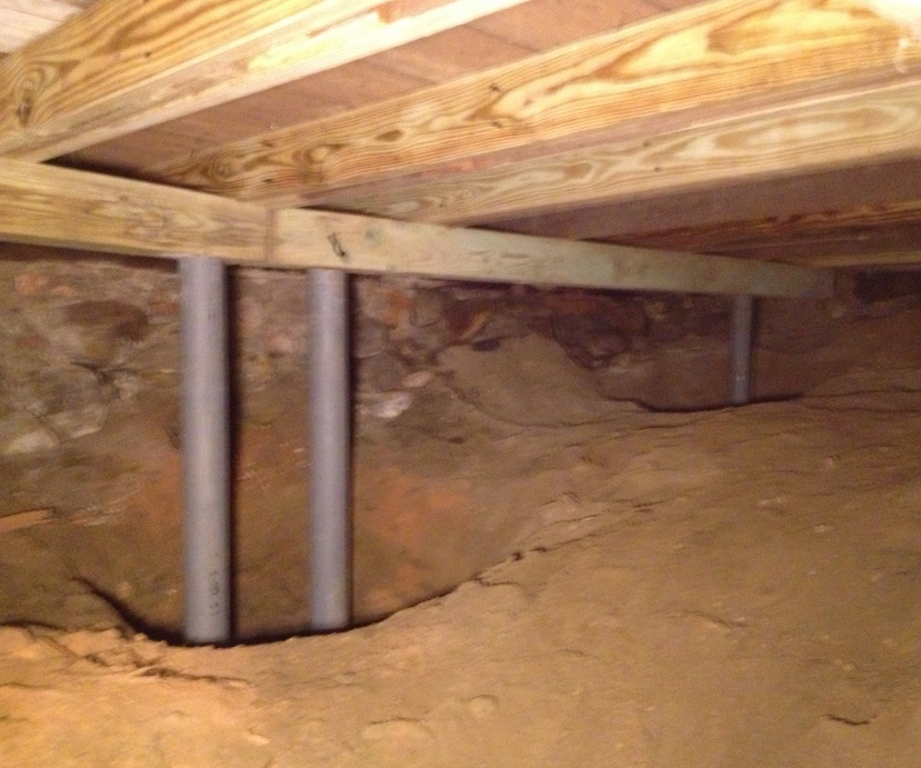 Poor framing/concrete pad work from contractor-basement.jpg