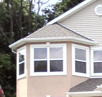 Seamless Gutter Around A Bay Window Roofing Contractor