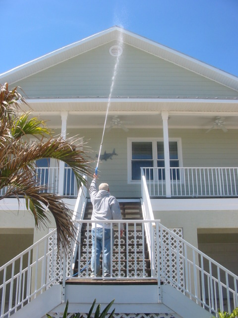 How do the roofing manufacturers say to clean roofing? Like this=-boca-grande-pressure-wash-job.jpg