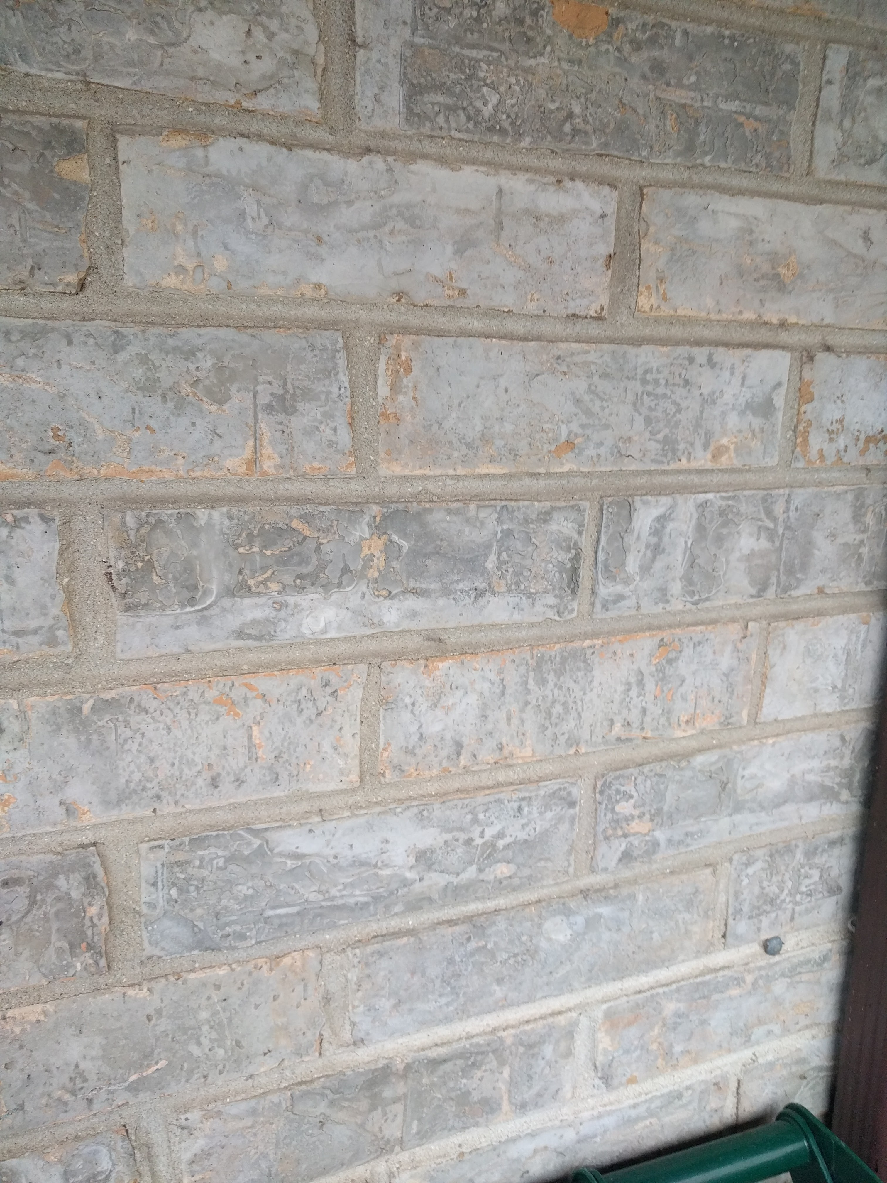 Replacement of Brick w/ a gray glaze/morter spread on face of it-brice-face-multiple-01.jpg