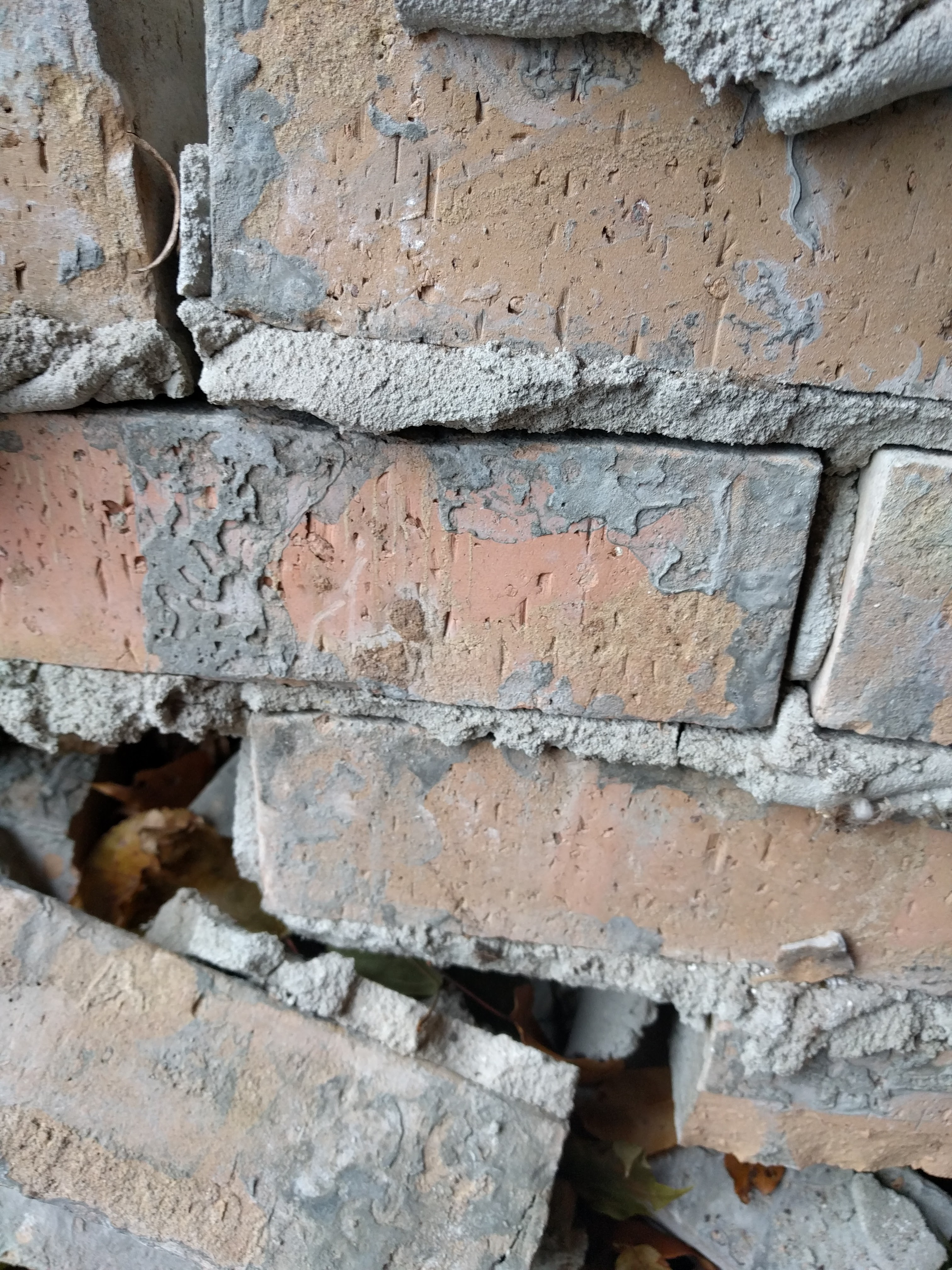 Replacement of Brick w/ a gray glaze/morter spread on face of it-brick-back-side-glaze.jpg