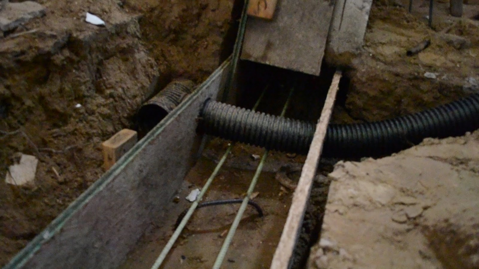 Crawlspace low point drain details Pacific NW-cap-1.jpg