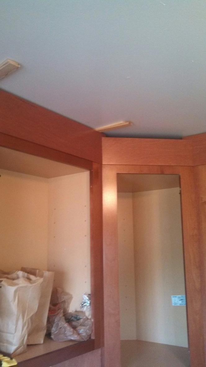 Kitchen cabinets - crown install w/ uneven toprail-crownfiller.jpg