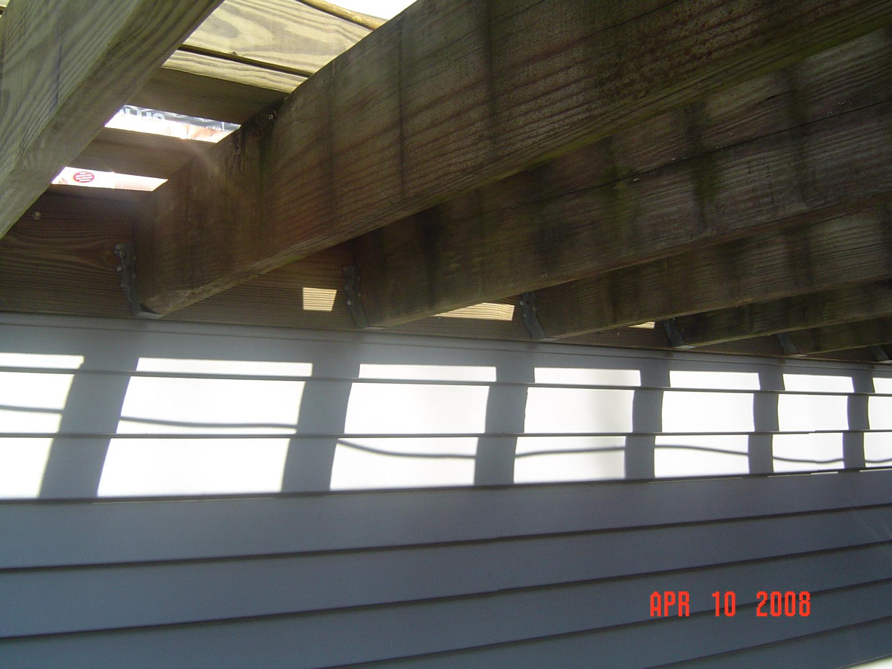 Attaching deck to house with siding - Tips On Removing Vinyl Siding For Attaching Ledger Board Dipalma Deck 021