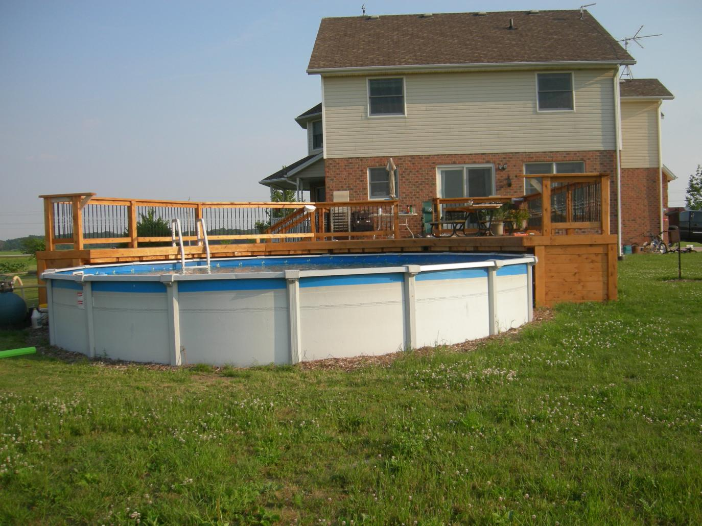 Pool deck 1200 square feet construction picture post for Above ground pool decks attached to house