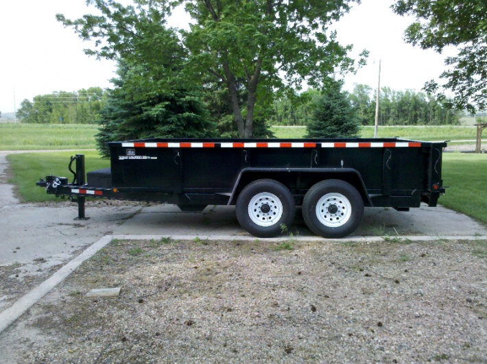 Small Dump Trailer on end dump tractor trailer