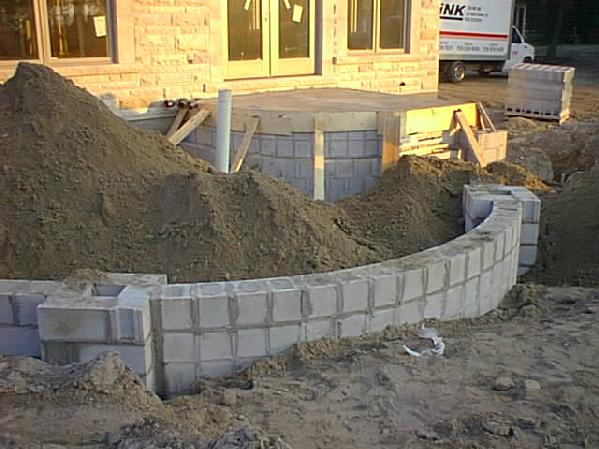 curved cmu wall w cultured stone masonry contractor. Black Bedroom Furniture Sets. Home Design Ideas