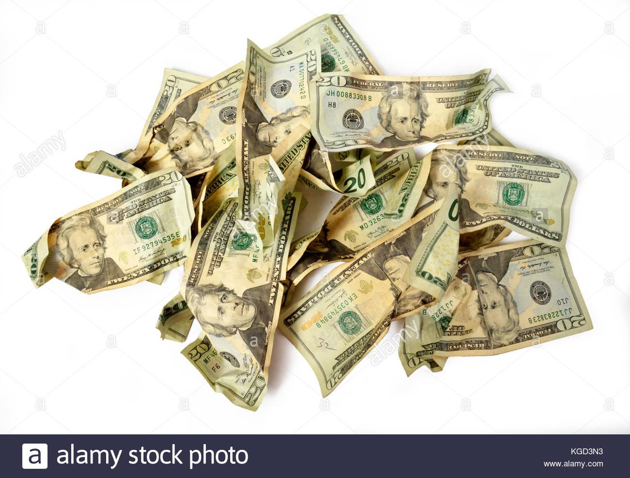 Got a bite on a swimming pool deck-horizontal-shot-pile-crumbled-twenty-dollar-bills-white-kgd3n3.jpg