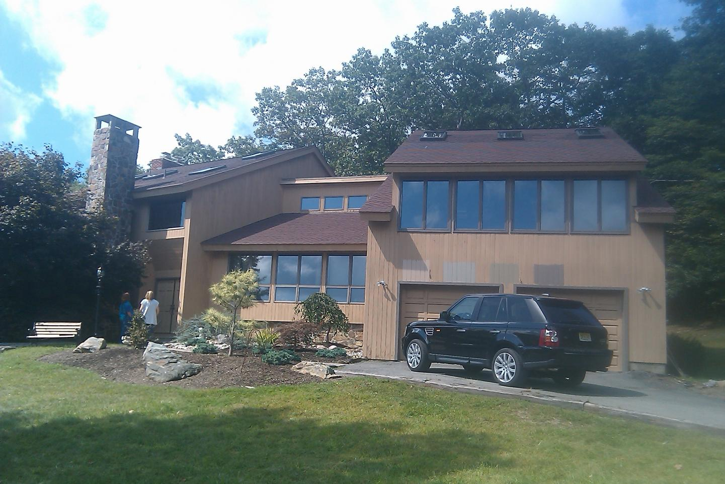 Log siding on a contemporary home windows siding and for Modern 80s house