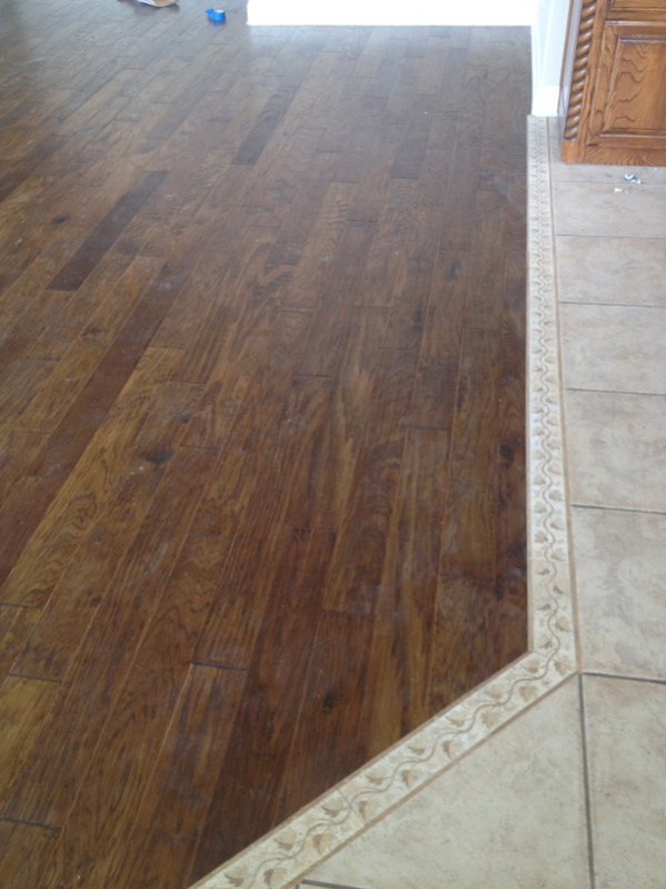 Transition from tile to hardwood tile design ideas for Hardwood floor contractors