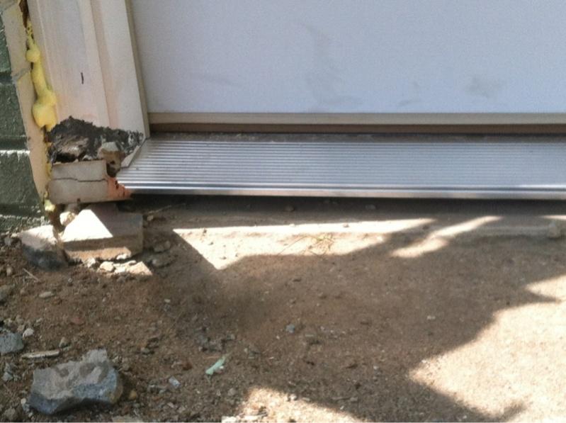 how to fix gap at bottom of door frame