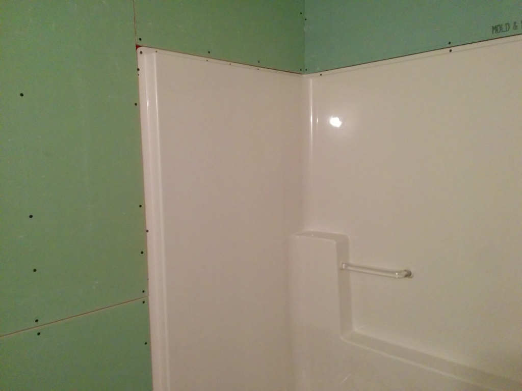 Installing Bathroom Tile Over Drywall : Screwing drywall around tub enclosures