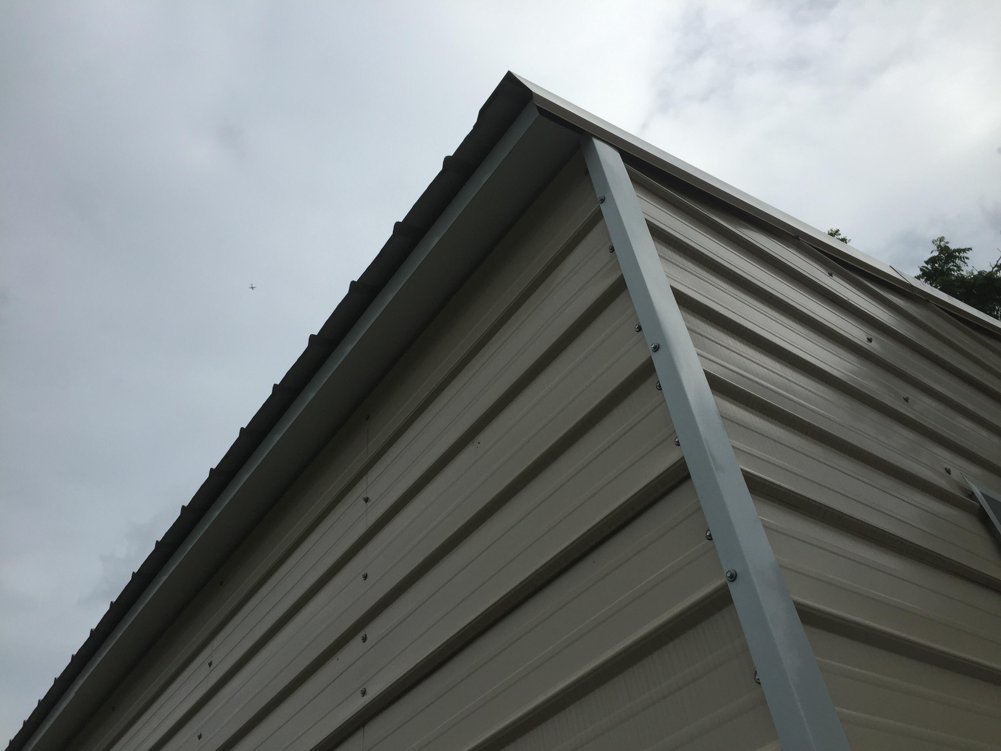 Hanging Gutter On Steel Building Construction