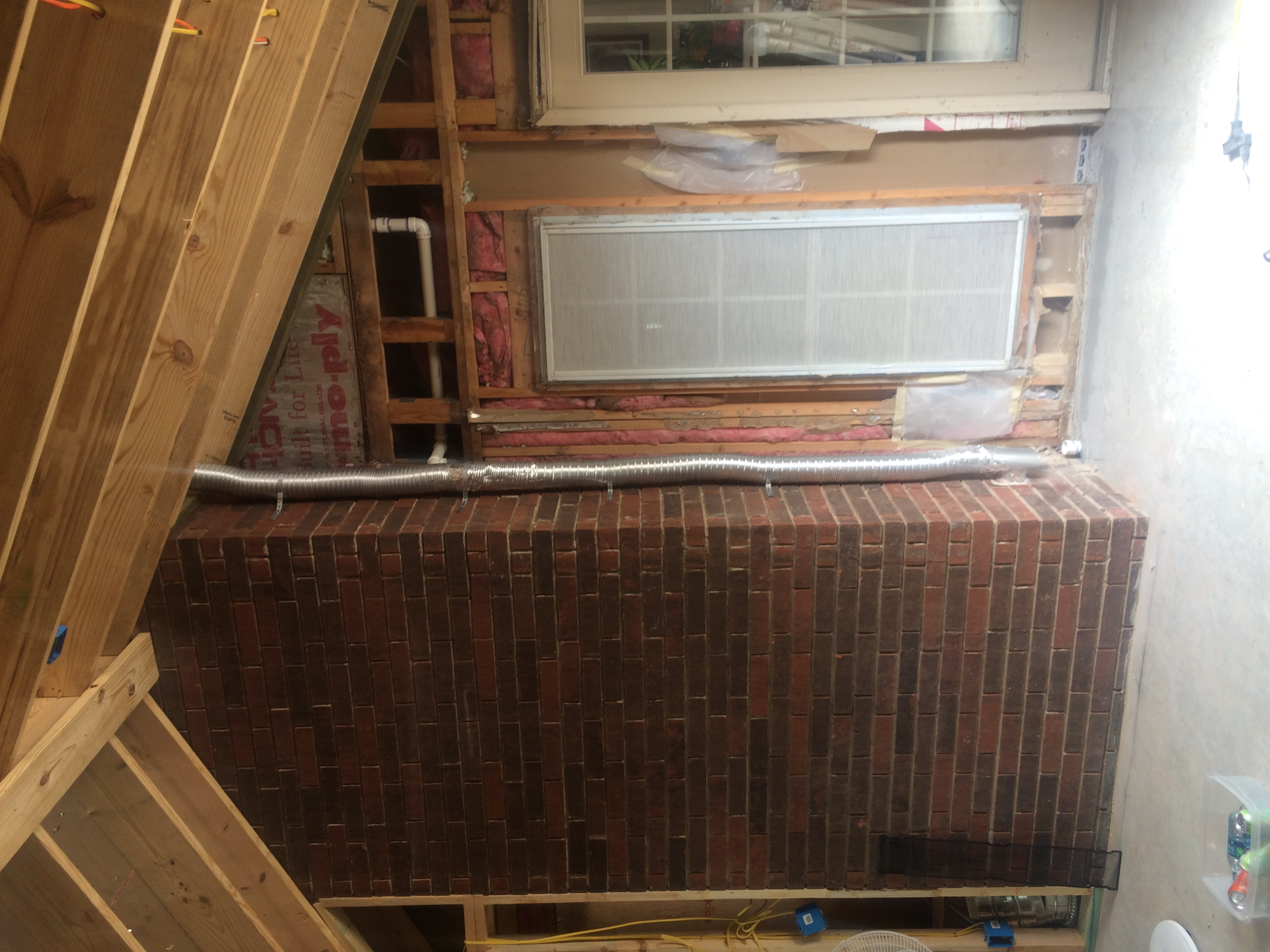 fireblocking around a brick chimney fireplace remodeling