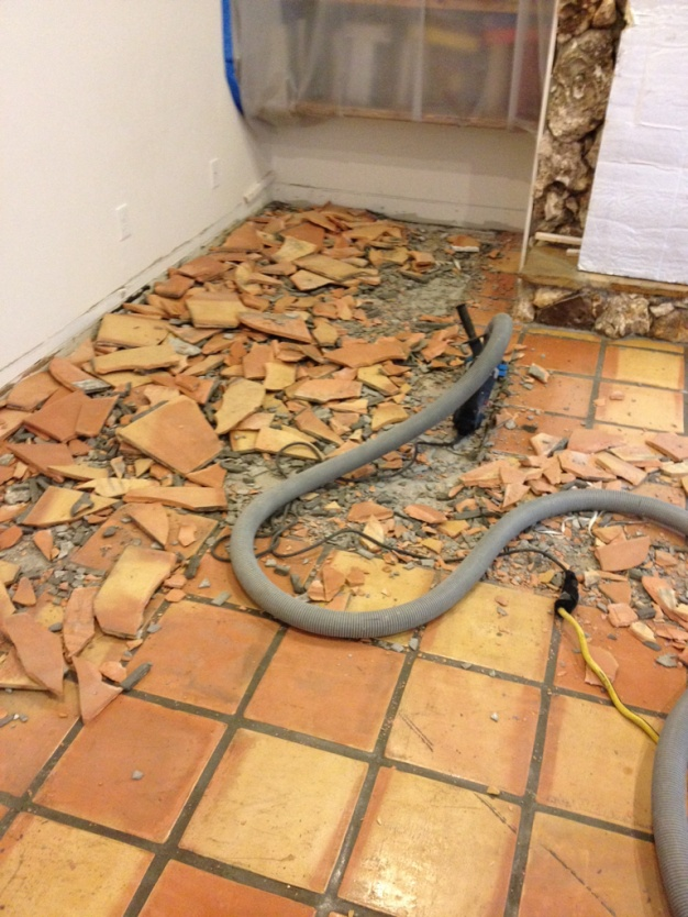 Removing ceramic floor tile from concrete slab