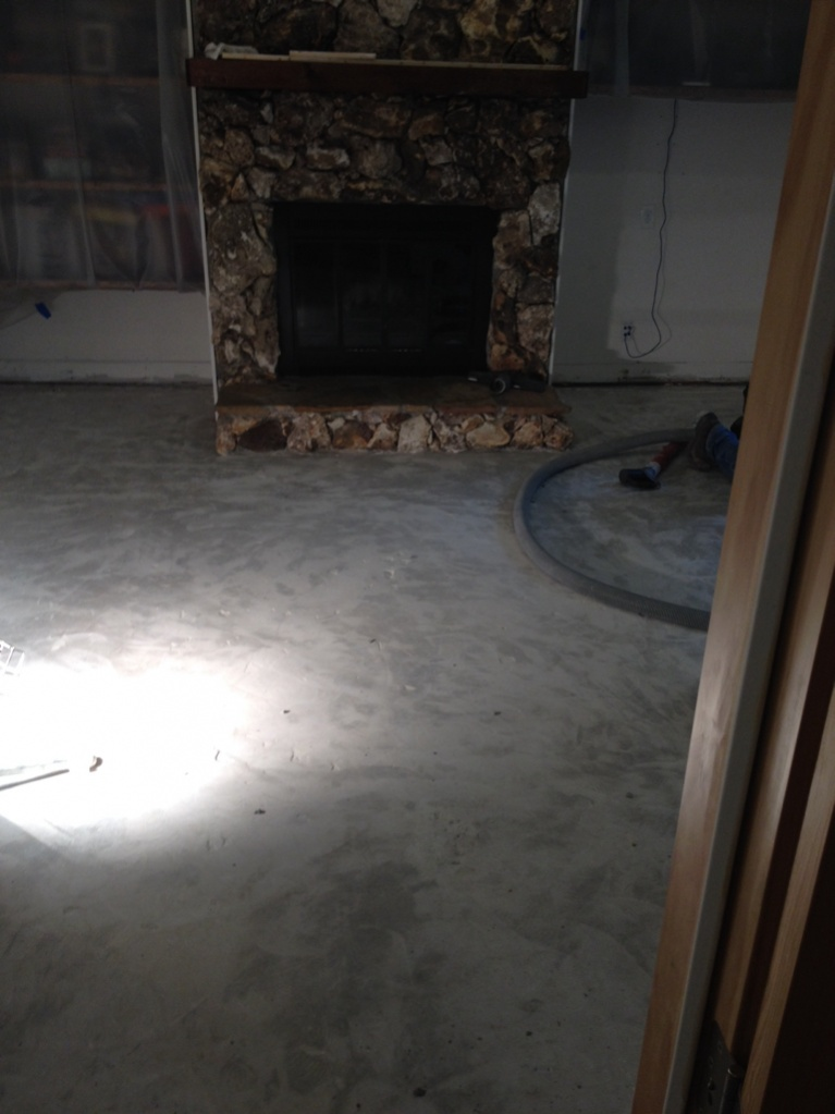 Ceramic tile removal from concrete slab flooring for Removing concrete floor
