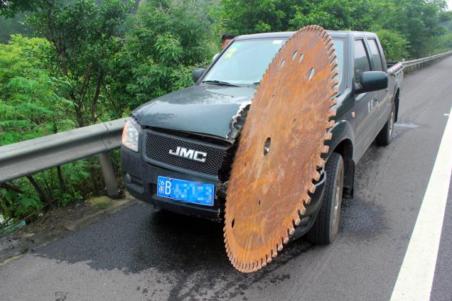 Runaway Saw Blade Slices Through Hood Of Truck, Barely Misses Driver-imageuploadedbycontractortalk1435185703.017219.jpg