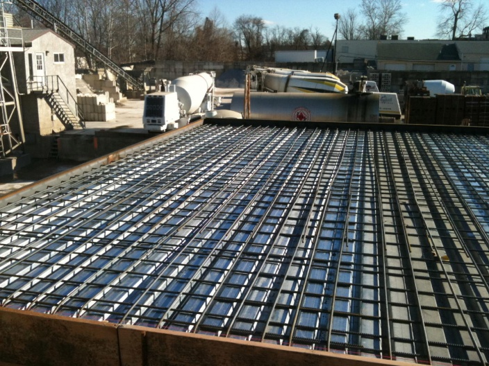 Concrete on elevated deck concrete paving contractor for Raised foundation vs slab