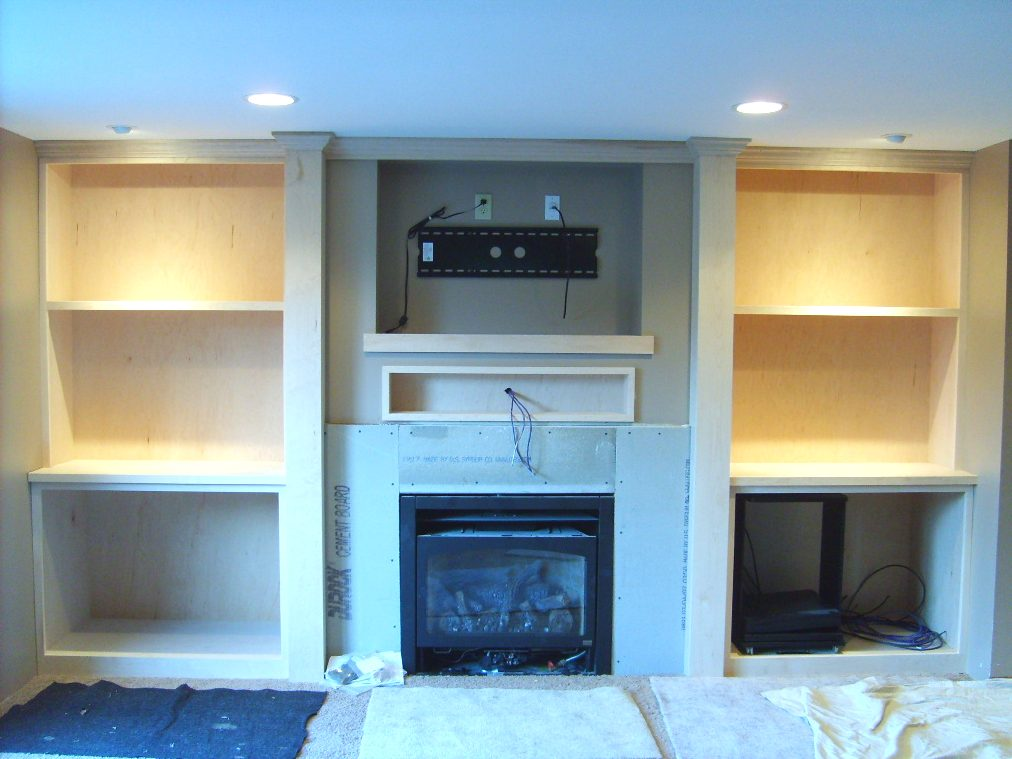 Fireplace mantel with flatscreen TV-maple-ent-ctr.jpg