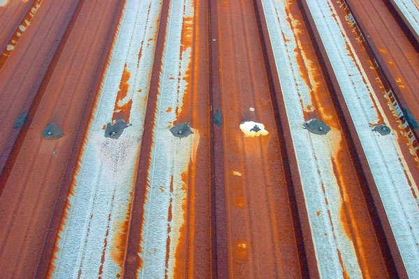 Tesla Solar Roof And Energy Business Narrative Continues To Fall Apart-metal-roof-deck-rusting-fasteners-popping-out.jpg