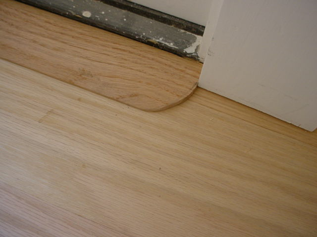 Wood Flooring Meets Metal For Sliding Glass Doors