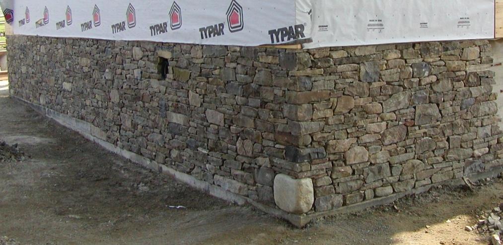 Granite Foundation Blocks : Natural fieldstone over painted interior concrete block