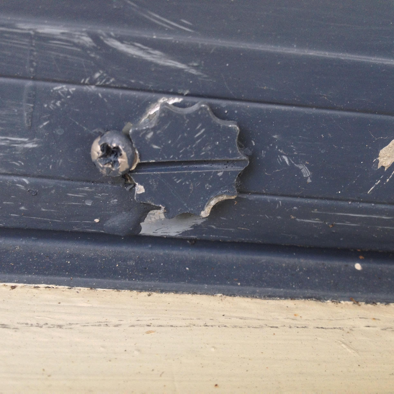 Old Patio door wheel adjustment screw-patio.jpg
