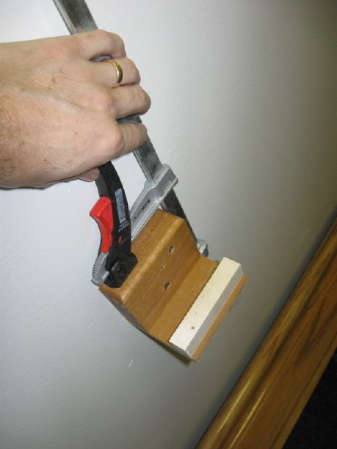 2x6 Rail Install-rail-holder-clamped.jpg