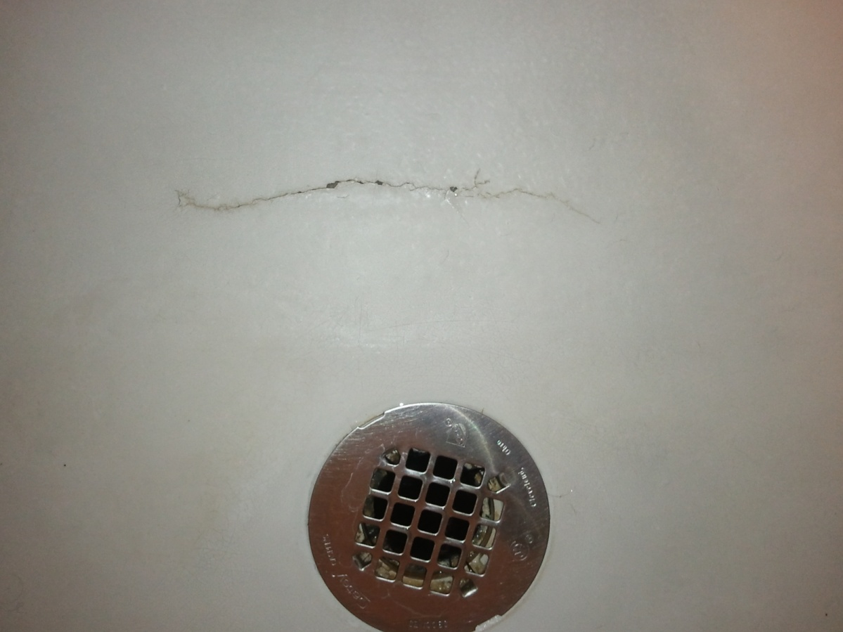 crack in prefab shower pan can it be repaired