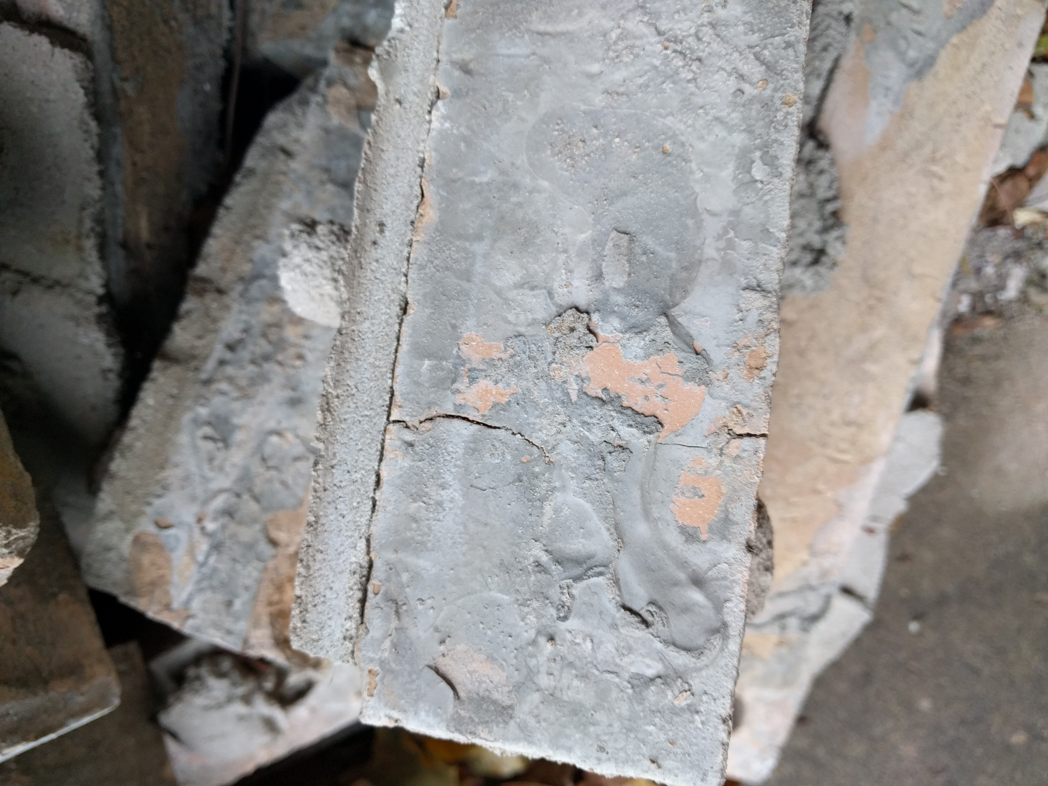 Replacement of Brick w/ a gray glaze/morter spread on face of it-single-brick-close-up.jpg