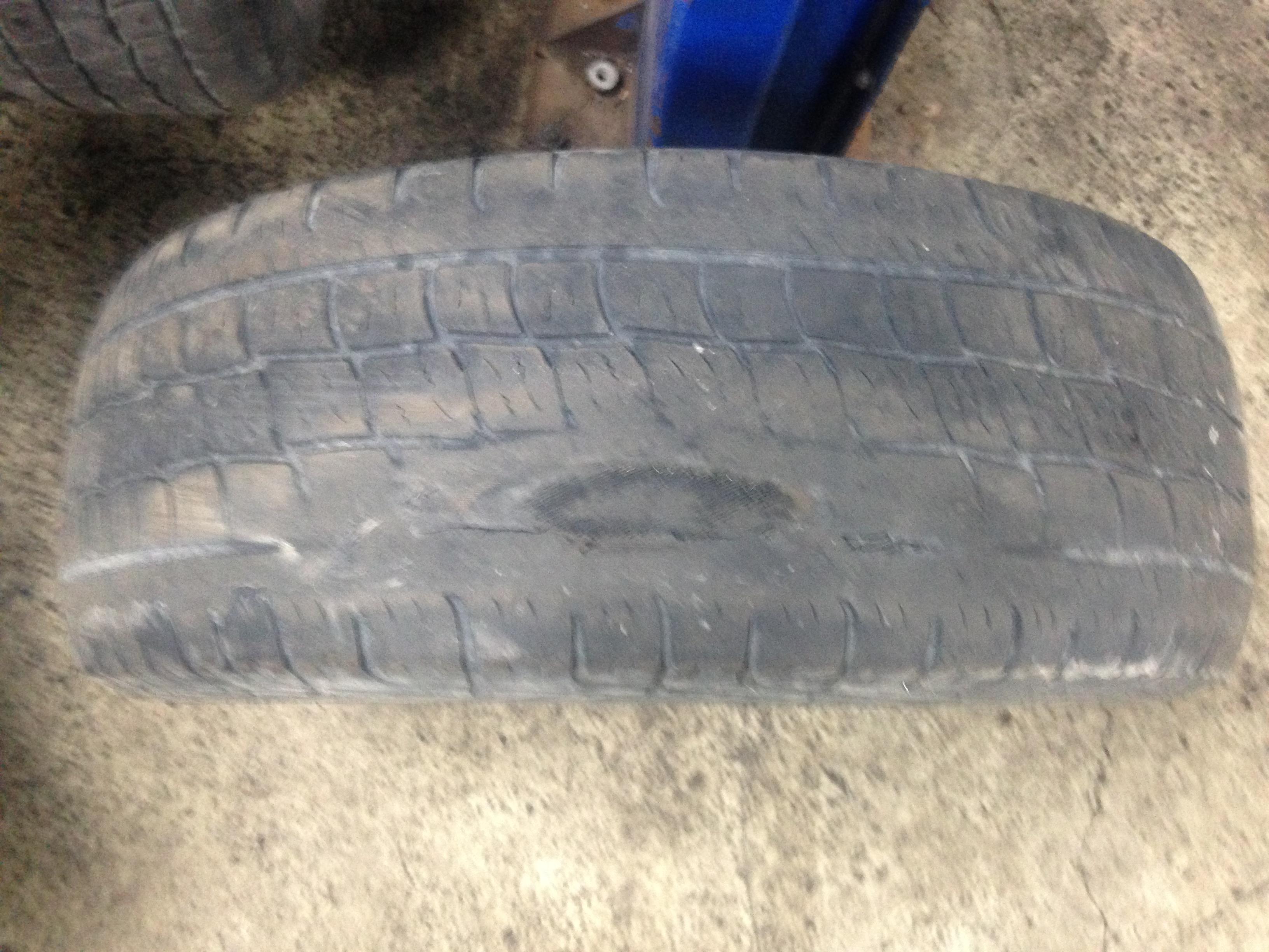 Tire is square? - Pound it round !-yukon-damaged-belt-tire.jpg