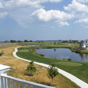 View from 3rd floor rear deck toward bay. Tee box #11, Jack Nicklaus golf course.