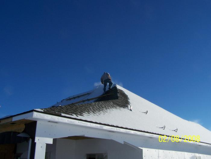 working on a roof during Winter
